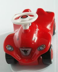 Ein Bobbycar - Physik, Geschwindigkeit, Bewegung, Bobbycar, Spielzeug, Fahrzeug, Lenkrad, rot
