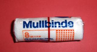 Mullbinde - Mullbinde, Kompresse, Binde, Verband, Mull, weiß, steril, Wunde, erste Hilfe, fixieren, Gaze, Verbandmittel