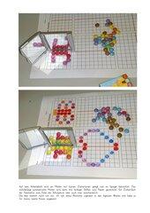 Spiegelsymmetrie mit bunten Zuckerlinsen
