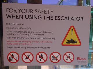 Hinweisschild in der  U-Bahn 09 - escalator, sign, English, tube, underground
