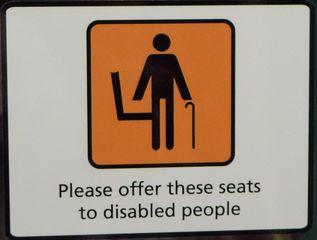 Hinweisschild in der  U-Bahn 08 - disabled people, sign, English, tube, underground