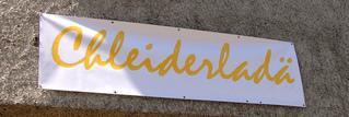 Chleiderladä - Schild, Beschriftung, Schweiz, Rätsel, Werbung