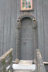 Stabkirche, Detail Eingang  - Stabkirche, Holzbau, Tür, Eingang, Ornamente, Verzierungen, keltisch, heidnisch, Wikinger, Holzschnitzereien