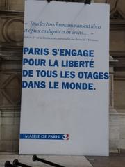 Plakat für die Menschenrechte - Landeskunde, civilisation française, Paris, Frankreich, französisch, Spruch, Menschenrechte, Geisel, Freiheit